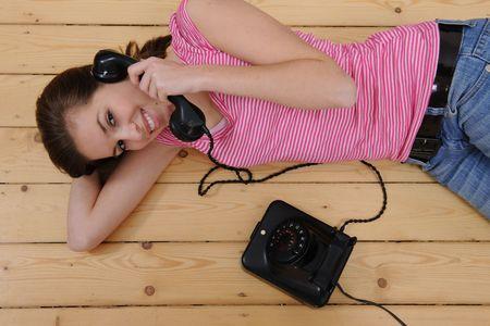 beautiful girl talking on phone photo