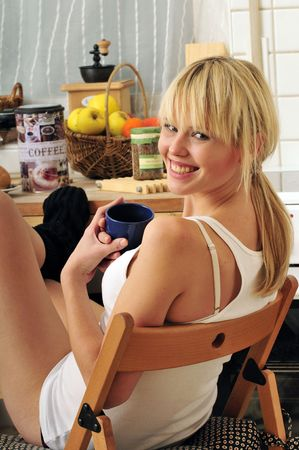 beautiful blond woman drinking a cup of coffee photo