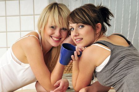 two girl friends drinking coffee a having a conversation