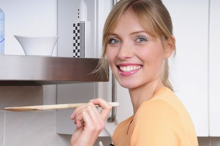beautiful blond woman cooking a tasty meal in a modern kitchen Stock Photo - 5166630