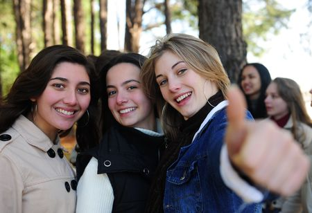 group of teenage girls on vacation during a trip in the forest photo