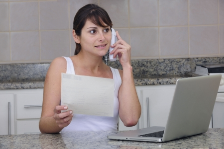 woman shopping online, talking on the phone photo