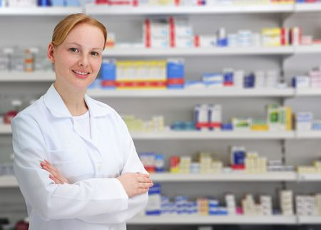 portrait of a female pharmacist at pharmacy photo