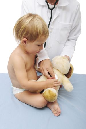 child and doctor examining a teddy-bear photo