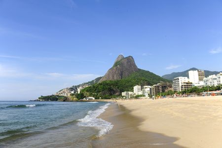 shantytown: View of Leblon beach with Pedra da Gavea and Favela do Vidigal in background. Stock Photo