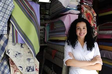 black fabric: small business: happy owner of a fabric store