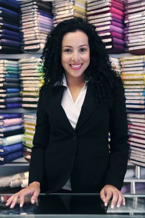 proprietor: small business: happy owner of a fabric store