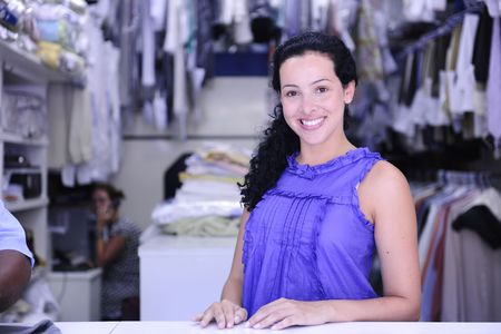 prádlo: small business: happy owner of a dry cleaning service