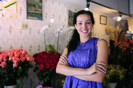 small business: happy owner of a flower shop photo