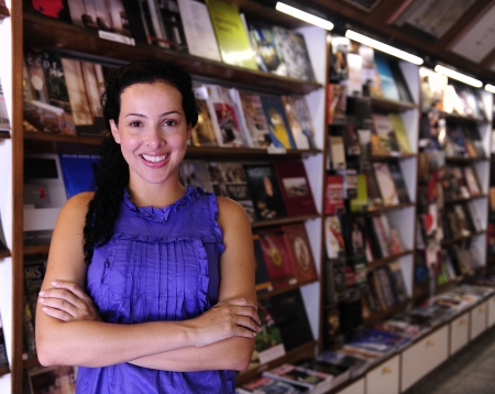 salesperson: small business: happy owner of a bookstore