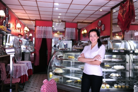proud and confident owner of a small pastry store  photo