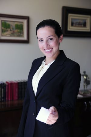 female lawyer at office giving business card photo