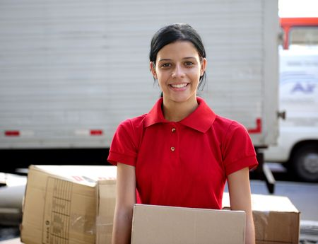 young delivery courier or mover delivering cardboards  photo