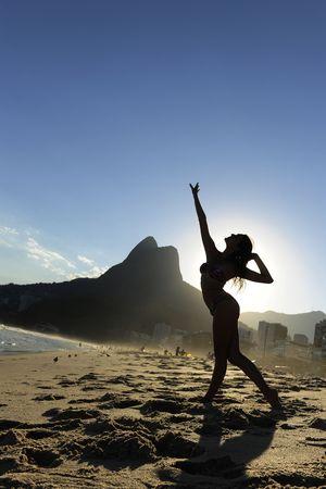 beautiful dancer performing on the beach, Rio de Janeiro photo