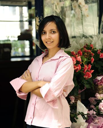 small business owner: proud woman and her flower shop photo