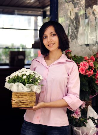 salesperson: small business owner: proud woman and her flower shop Stock Photo