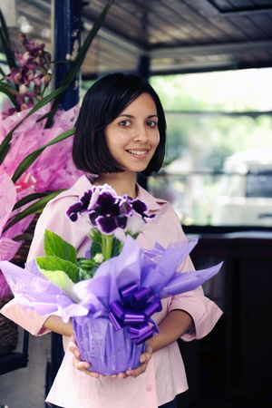 florists: small business owner: proud woman and her flower shop Stock Photo