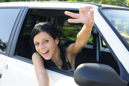new car: teenage girl showing victory sign photo