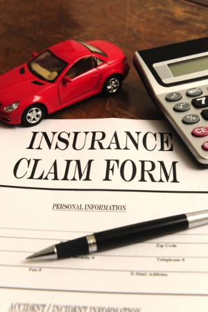 midget: car insurance claim form on desk