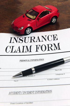 car insurance: car insurance claim form on desk
