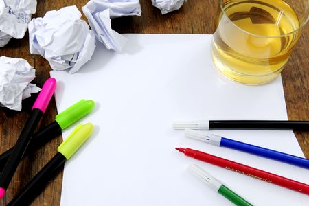 creativity problems: blank paper on desk with many paperballs  and whiskey Stock Photo - 6831577