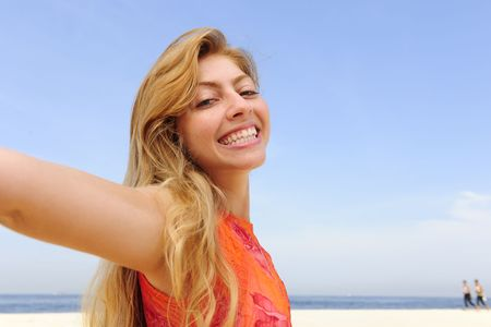 freedom: beautiful blond woman on the beach photo