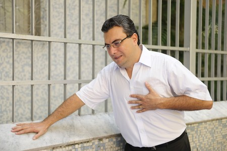 Sudden chest pain: Man having a heart attack bending Stock Photo - 6990167