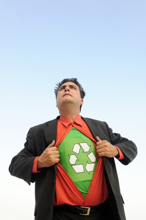 proud to recycle: businessman is a recycling hero photo