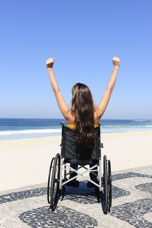 summer vacation: wheelchair person enjoying outdoors beach photo