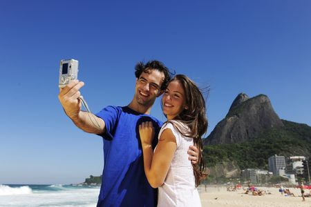 tourist couple in Rio de Janeiro taking a photo with a digital compact camera Stock Photo