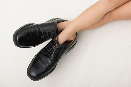 Corporate succession: child with father�s tie and shoes photo