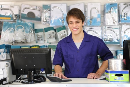 portrait of a sales assistant behind the counter of a building  center photo