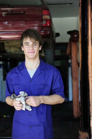 apprentice: portrait of a car mechanic at work at the car  repair  shop Stock Photo