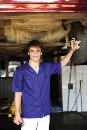 car repair shop: portrait of a car mechanic at work at the car  repair  shop Stock Photo