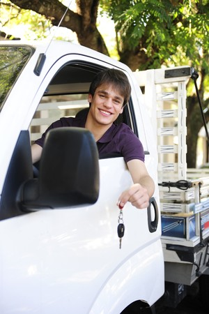 happy owner of a new truck showing car keys photo