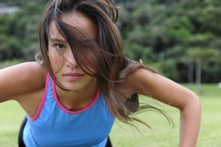 pushup: attractive, sporty woman doing push-ups outdoors in the park