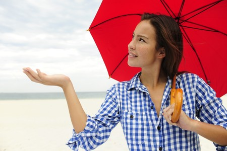 forcast: insurance: woman with red umbrella touching the rain