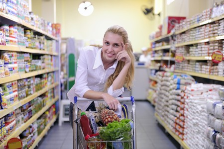 Happy blond woman shopping in the supermarket photo