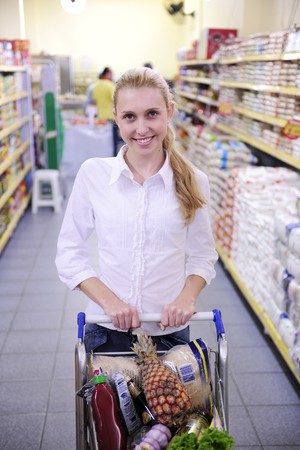 Happy blond woman shopping in the supermarket Stock Photo - 7754201