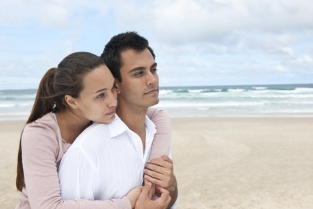 romance on vacation: couple in love on the beach
