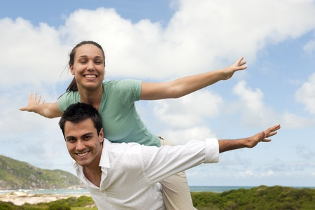 happy hispanic couple in love, man giving piggyback to woman photo