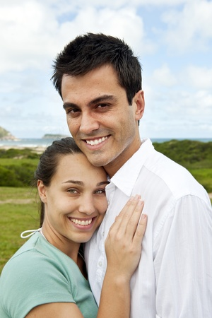 portait of a happy hispanic couple smiling outdoors photo