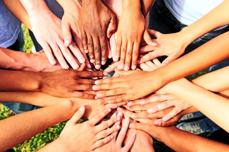 huddle: many hands together: group of people joining hands showing unity and support Stock Photo