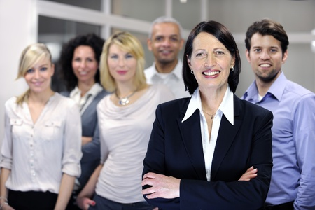 mature businesswoman and business team at office Stock Photo - 12632905