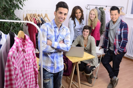 business cloth: portrait of fashion designer team at work at office