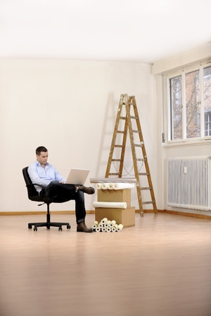 refurbishing: Architect or owner in empty office room