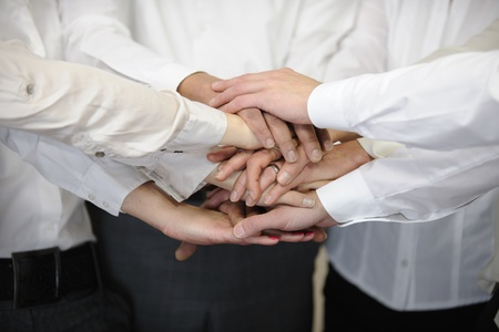 Closeup of a business team with hands together Stock Photo - 12632885