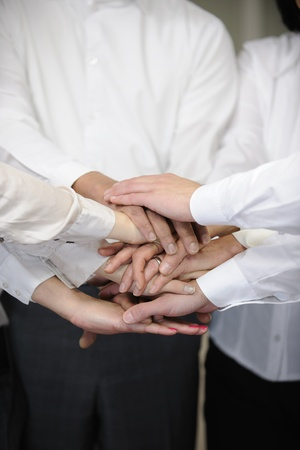 Closeup of a business team with hands together Stock Photo - 12632884
