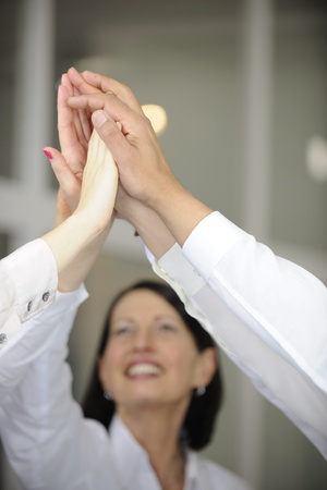 Business team celebrating success with high five, copyspace photo