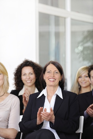 Business team applauding after a conference in a company Stock Photo - 12632869